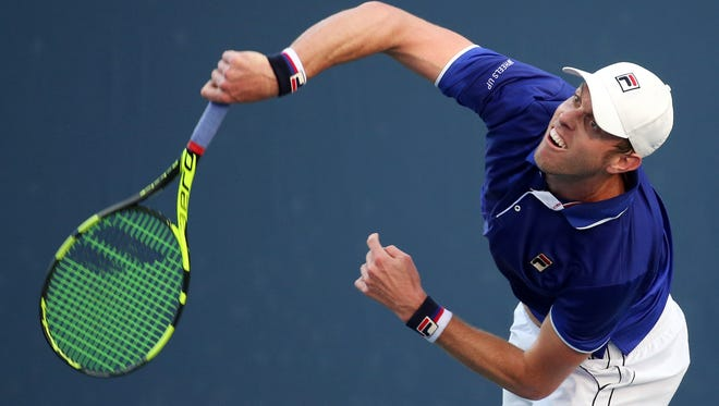 Sam Querrey rips a serve during his three-set win over Israel's Dudi Sela at the U.S. Open on Wednesday. The 29-year-old had 19 aces to reach the third round.