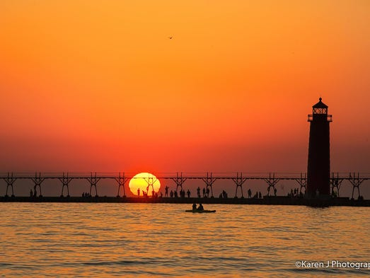 Sunset at Grand Haven State Park in Michigan casts
