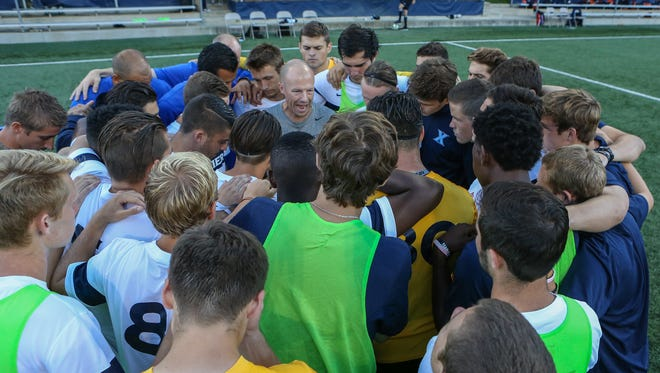 Coach Andy Fleming (center) and Xavier's soccer team host the fifth annual Down Syndrome Awareness Classic April 23. XU and Michigan State play at 7:30 p.m. at the XU Soccer Complex.