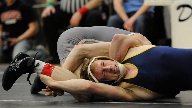 Lancaster's Tanner Miller wrestles Olentangy Liberty's Trey Grenier in the 145-weight class during the Division I District wrestling tournament Saturday at Hilliard Darby High School.