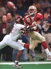 VT's Ronyell Whitaker is called for interference on this pass to Peter Warrick in the 4th quarter. Somehow, Warrick caught the ball for a touchdown to lead the Seminoles to a national championship in the 2000 Sugar Bowl.