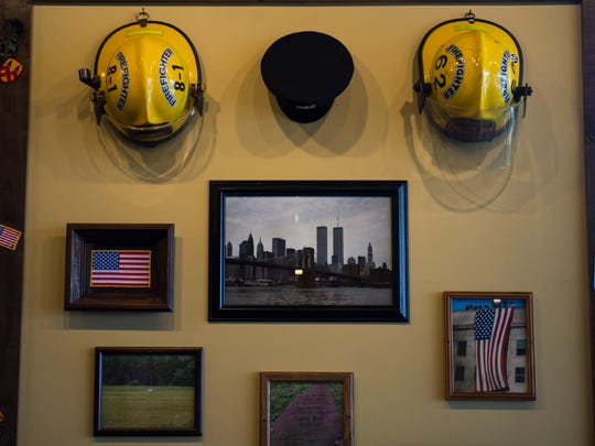The walls of Mission BBQ in Deptford feature an array of memorabilia in support of first responders.