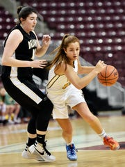 York Catholic's Kate Bauhof drives past Delone Catholic's Bradi Zumbrum in the first half of the PIAA District 3 Class 3A girls' basketball title game Thursday, March 2, 2017, at the Giant Center in Hershey. York Catholic defeated Delone Catholic 57-46 to earn its 11th district championship in 12 years, as well as head coach Kevin Bankos' 300th career win.