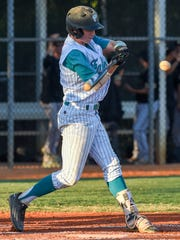 Jensen Beach's Caleb Pendleton (9) connects with ball Tuesday, April 3, 2018, during his team's high school baseball game against Treasure Coast at Jensen Beach High School. To see more photos, go to TCPalm.com.