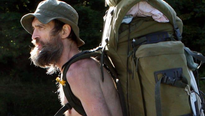 A 2012 photo shows Stephen Gough, nicknamed the Naked Rambler, walking near Selkirk, Scotland. G