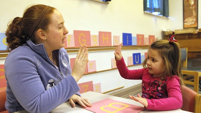 Jennifer Meister teaches Phoebe Krause how to sign in the k-2 class at the St. Rita School for the Deaf in 2010.