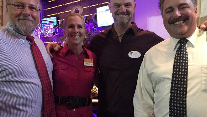 Jeff Staner, Shelley Starner, Owen Feeney, and Mark Geschwendt enjoy the Estero Chamber of Commerce Holiday Party on Dec. 4 Ford's Garage in Miromar Outlets.
