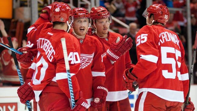 Detroit Red Wings players celebrate a goal against the Ottawa Senators at Joe Louis Arena.