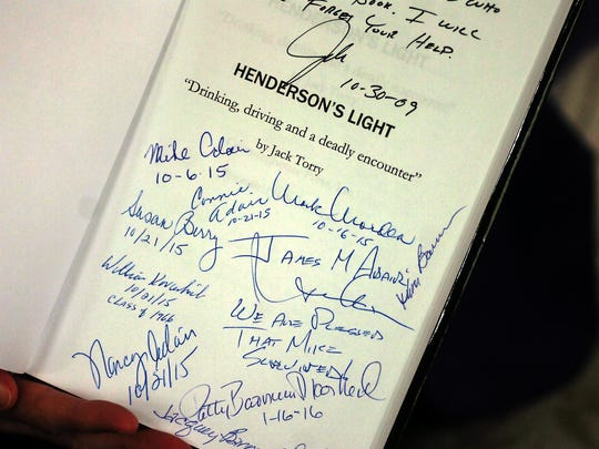 """Nancy Henderson is collecting the signatures of dozens of people who were interviewed for """"Henderson's Light."""""""