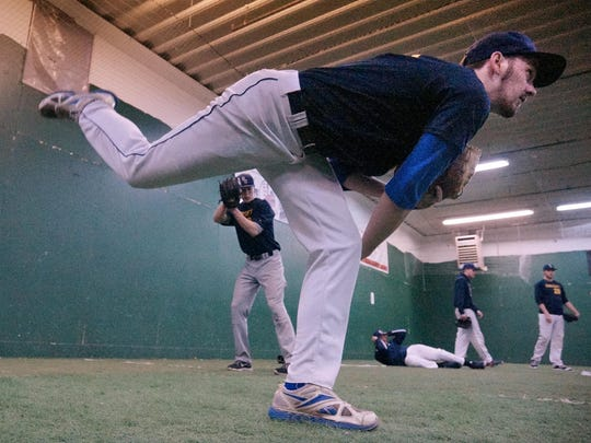 Getting in some reps Wednesday is Schoolcraft pitcher Nick Montroy, who played for Garden City. Behind him is Donovan Thacker, who played for Southgate Anderson.