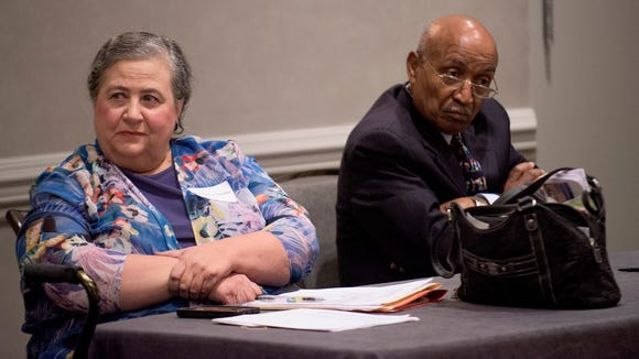 Nancy Worley and Joe reed listen as Artur Davis speaks to the Executive Board of the Alabama Democratic Conference in Hoover, Ala. on Friday October 16, 2015. Davis is asking to be accepted back into the Democratic Party.