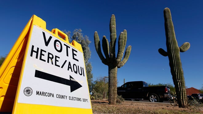 A Maricopa County Elections Department sign directs voters to a polling station on Nov. 8, 2016, in Cave Creek, Ariz.