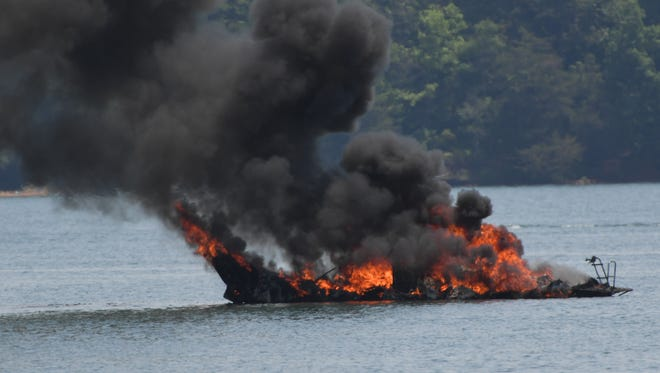 Multiple stations from Anderson County putting out fire at dock 6 of Portman Marina in Anderson on Monday.
