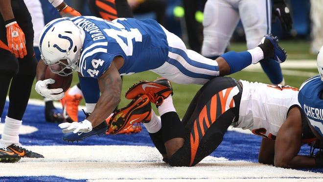 Colts running back Ahmad Bradshaw scores a touchdown in the second quarter against the Bengals. Indianapolis hosted Cincinnati at Lucas Oil Stadium Sunday, October 19, 2014.