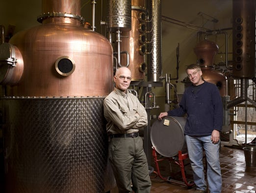 Ralph Erenzo, left, and Brian Lee, co-owners of Tuthilltown Spirits in Gardiner, N.Y., stand near the still.