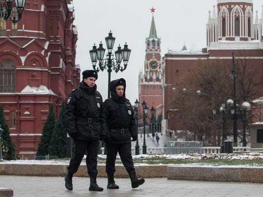 Russian police officers patrol the Manezh Square at the Kremlin in Moscow, Russia, Thursday, Nov. 30, 2017. The Final Draw for the 2018 FIFA World Cup in Russia will take place on Friday, Dec. 1, 2017, at the State Kremlin Palace in Moscow. (AP Photo/Denis Tyrin)