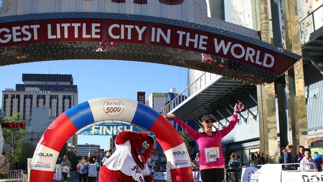 Runners at the Reno Arch during the  Reno Running and Fitness Downtown River Run Marathon in 2014.