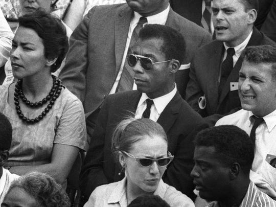 """James Baldwin, center, in """"I Am Not Your Negro."""" In Raoul Peck's Oscar-nominated documentary, Baldwin's searing observations on race and America are resurrected for today. The film opens Friday at Small Star Art House."""