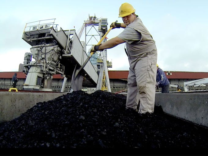 Jason Benac, 39 of Sault Ste. Marie moves coal around