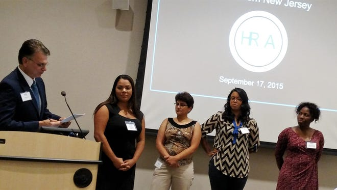 (From left) Armando Riccio, president of the Human Resource Association of Southern New Jersey, installs some of the officers of the 2015-16 Society for Human Resource Management Student Chapter of Cumberland County College: Suleika Rodriguez, president; Betsy Andrion, first vice president; Karen Figueroa, second vice president; and Shernette Morais, co-treasurer.