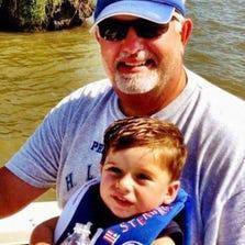 Peter Verrett III is shown with his grandson, Nikko.
