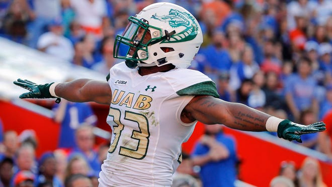 UAB Blazers cornerback Brontae Harris reacts as he breaks up a pass in the end zone against the Florida Gators during the first quarter at Ben Hill Griffin Stadium.