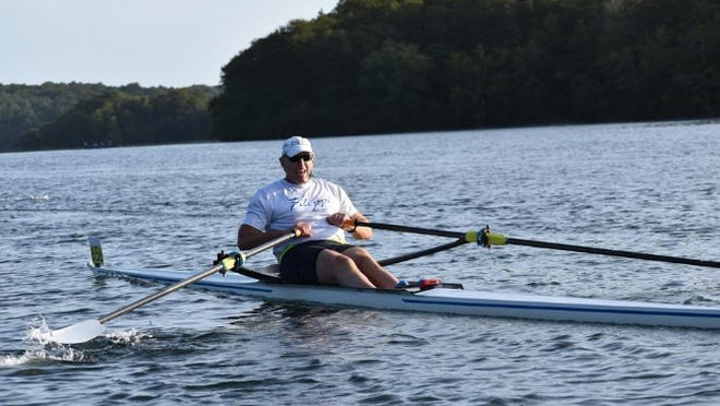 Tom Darling, of Lincoln, rows on a single scull during the inaugural Head of the Ponds Regatta on Sunday morning at Mashpee-Wakeby Ponds in Mashpee. Darling is a three-time former U.S. Olympic rower who earned a silver medal in the 1984 Summer Olympics.