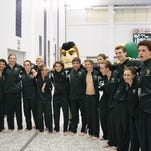 The Howell swim team celebrated senior night by defeating Brighton and making school history as the first team to ever go 8-0 in dual meets in a season.