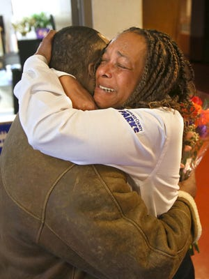 Dee McCollum, director of the Dr. Martin Luther King Jr. Community Center at 1531 W. Vliet St. in Milwaukee, gives Antonio Franklin a hug. Franklin had a heart attack while exercising at the center and was saved by McCollum and another worker, Antonio Moore.