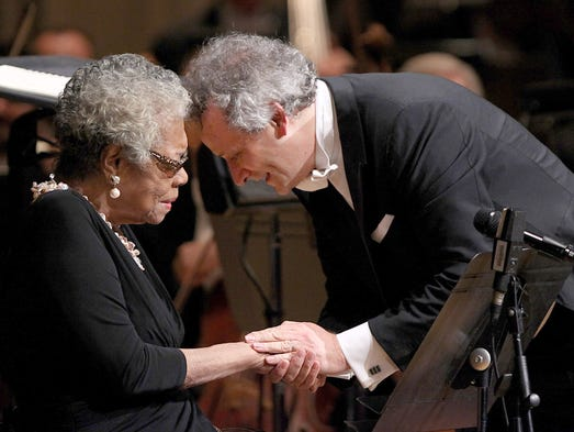 "November 2013: Dr. Maya Angelou, left,  is congratulated by  Cincinnati Symphony Orchestra music director Louis Langree, after they performed Copland's ""Lincoln Portrait"" on Nov. 8, 2013, at Music Hall."