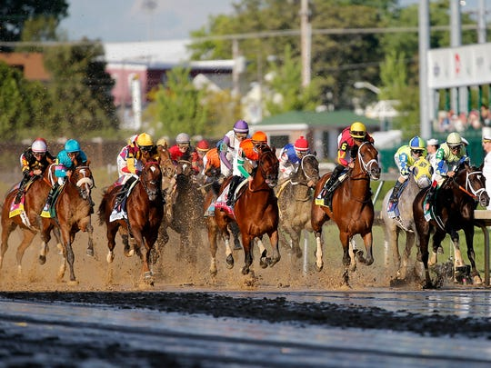 Always Dreaming, far right, wins the 143rd running