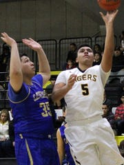 Scotti Velasco, right, puts up a shot Saturday afternoon. Alamogordo fell to El Paso Cathedral 41-36.