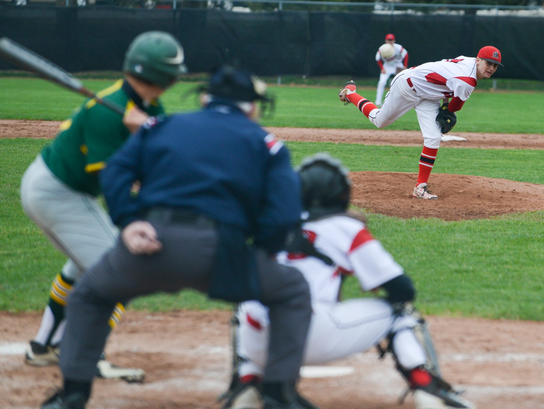 Marshall's Drew Devine pitches against Pennfield earlier this season.