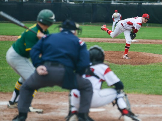 Marshall's Drew Devine pitches against Pennfield earlier
