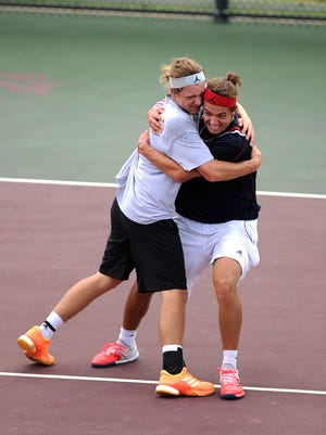 Corpus Christi Veterans Memorial's Jason Lloyd (left) celebrates with partner Michael Lloyd after their win in the Class 5A boys doubles state championship match over Austin Johnson at the UIL State Tennis Championships on Thursday, May 18, 2017, at the George P. Mitchell Tennis Center in College Station.
