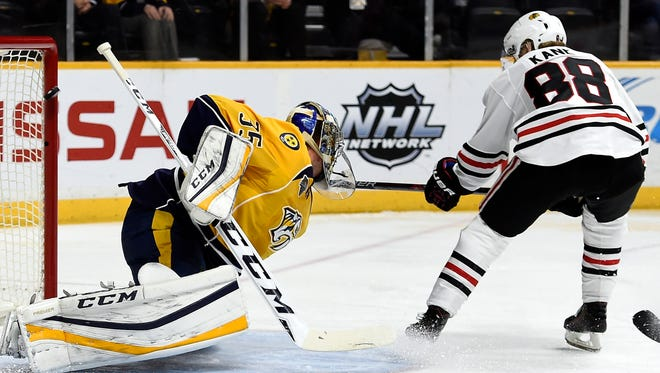 Blackhawks right wing Patrick Kane (88) scores a goal past Predators goalie Pekka Rinne (35) in the second period Tuesday.