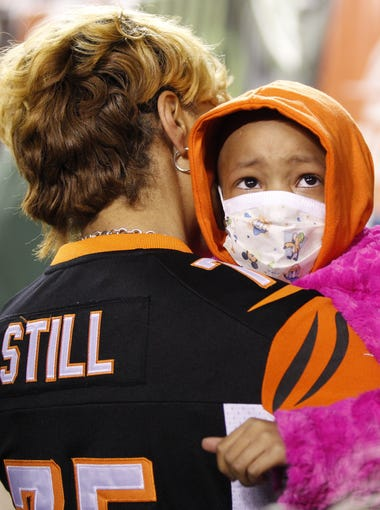 Leah Still watches as fans call her name while she