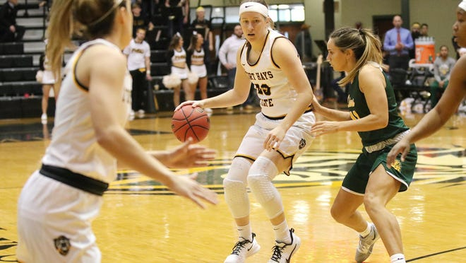 Former Fort Hays State University guard Kacey Kennett is a student assistant coach for the Tigers .