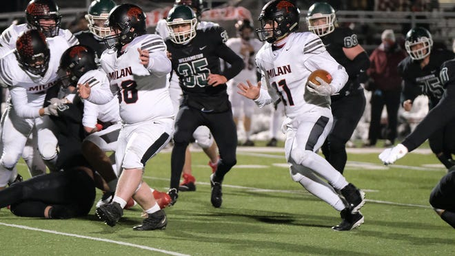 Quarterback Cole McElvany runs the ball for Milan during game last season. Milan opened its 2021 football season with a 29-22 win over Warren Michigan Collegiate Saturday night.
