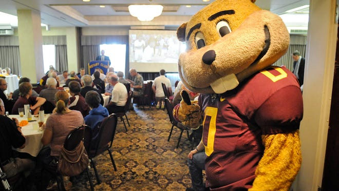 University of Minnesota mascot Goldy stands at the door to greet people during Wednesday's Gopher Road Trip stop in St. Cloud.