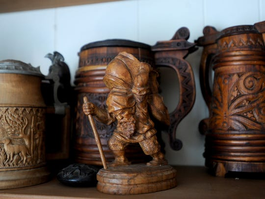 Some of the beer steins made of wood that are part of Terry Hill's collection are on display on a shelf in the den of Hill's Ojai home.