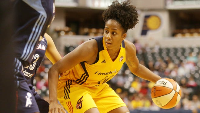 The Indiana Fever's Shenise Johnson looks for a hole in the defense as the Indiana Fever play the Atlanta Dream at Bankers Life Fieldhouse, Friday May 20th, 2016. The Fever beat the Dream 94 to 85.