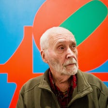 In this Sept. 24, 2013, file photo, artist Robert Indiana, known world over for his LOVE image, is interviewed in front of that painting at New York's Whitney Museum of American Art.