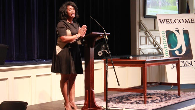 Amber DuVentre, director of program implementation for faith communities at the Governor's Foundation for Health and Wellness, speaks Friday at First United Methodist Church.