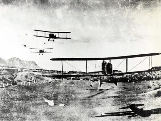 02 FEB 1920 - FLY BY - Planes of the 1st Surveillance Group fly by in salute to General John J. Pershing, February 2, 1920. Note observer in lead plane executing hand salute as plane flies over what is today Armstrong Field, Fort Bliss. (Credit: U.S. Army Photo)