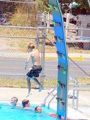The climb takes his jump from the wall into the pool.