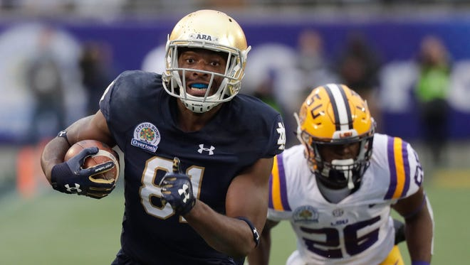 Notre Dame wide receiver Miles Boykin, left, runs to the end zone past LSU safety John Battle (26) on his way to the score the game-winning touchdown during the second half of the Citrus Bowl NCAA college football game Monday, Jan. 1, 2018, in Orlando, Fla. Notre Dame won 21-17.