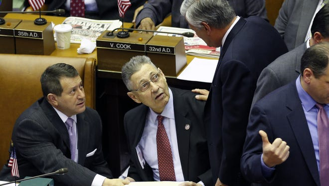 Senate Republican leader Dean Skelos, R-Rockville Centre, right, talks with Assembly Majority Leader Joseph Morelle, D-Rochester, left, and Assembly Speaker Sheldon Silver, D-Manhattan, during a joint session of the Legislature in the Assembly Chamber at the Capitol on Tuesday in Albany.