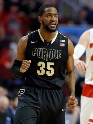 Purdue's Rapheal Davis (35) celebrates a basket against Wisconsin in the first half of an NCAA college basketball game in the semifinals of the Big Ten Conference tournament in Chicago, Saturday, March 14, 2015.  (AP Photo/Michael Conroy)
