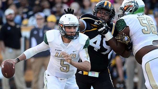 UAB quarterback Cody Clements (5) scrambles out of the backfield during an NCAA college football game against Southern Mississippi on Saturday, Nov. 29, 2014, in Hattiesburg, Miss. (AP Photo/Hattiesburg American, Eli Baylis)